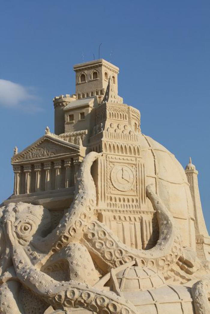 Sand sculpture of-polpo-holding-big-building