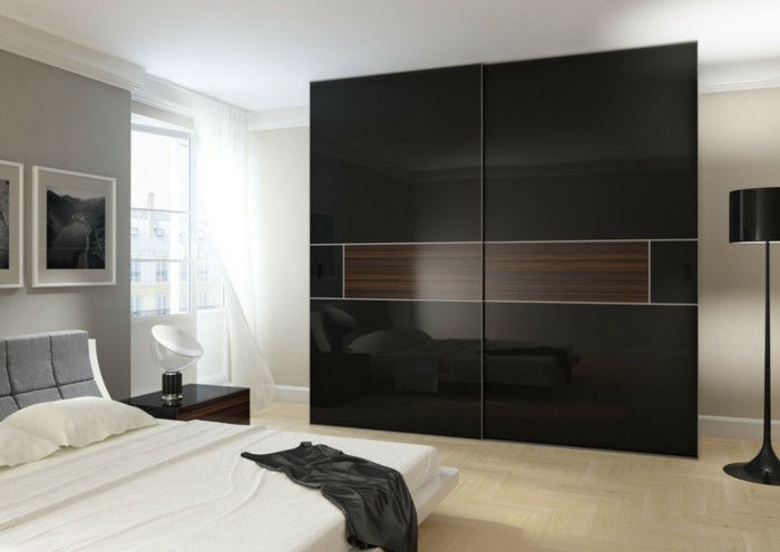 porte-proprio-build-con-elegante-nero-design-in-moderno camera da letto di scorrimento