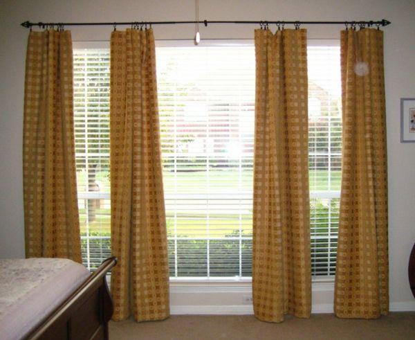 goudkleurige gordijnen oranje nuances en blinds